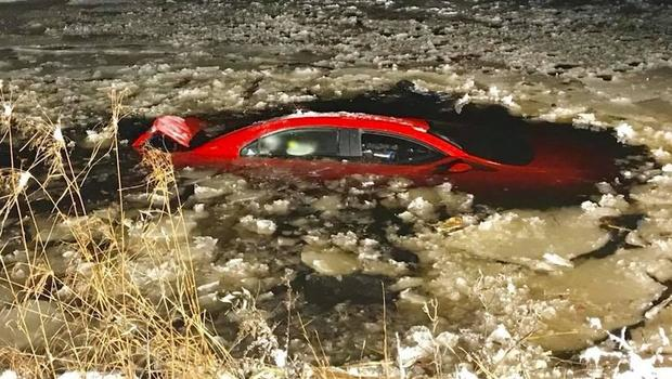 Man rescued from auto after driving into pond