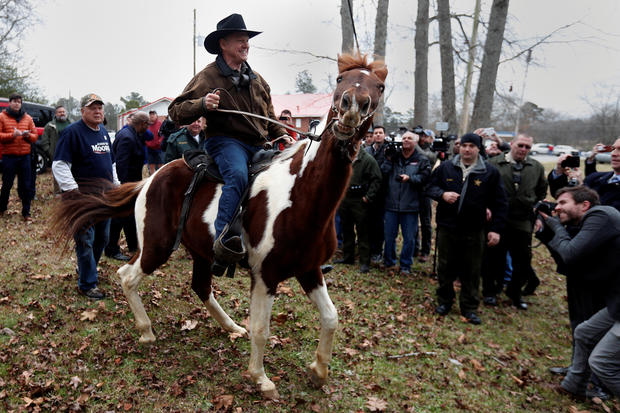 Republican Senate candidate Roy Moore departs on horseback after he cast his ballot in Gallant, Alabama