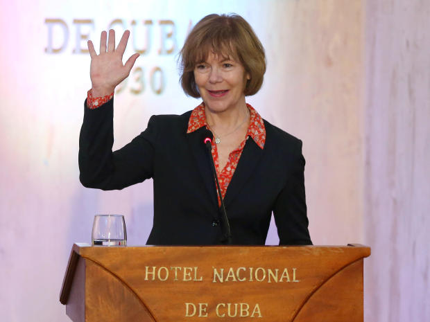 FILE PHOTO: Minnesota Lt. Governor Smith waves to journalists at the end of a news conference in a Hotel in Havana