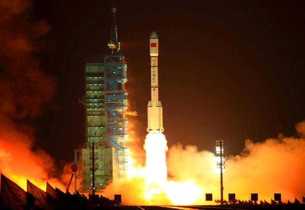 China's Long March 2F rocket carrying th