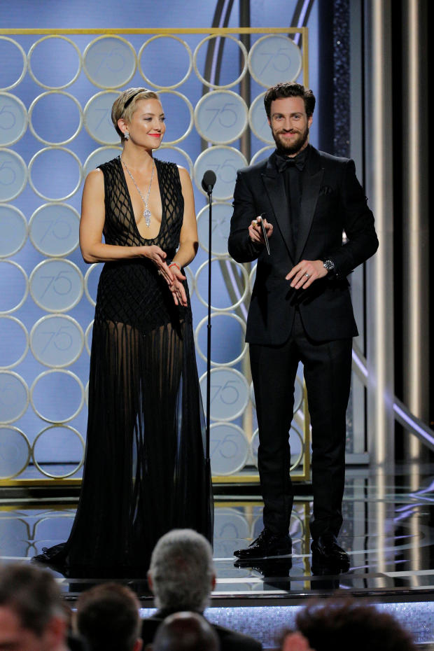 Presenters Kate Hudson and Aaron Taylor at the 75th Golden Globe Awards in Beverly Hills, California