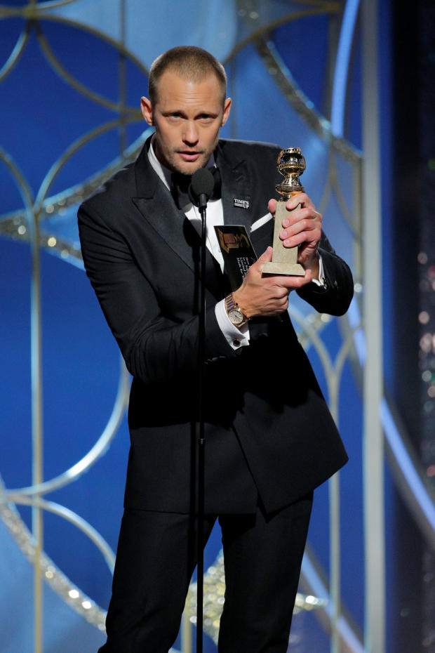 """Alexander Skarsgaard holds his award for Best Performance by an Actor in a Supporting Role in a Series, Limited Series, or Motion Picture Made for Television for """"Big Little Lies"""" at the 75th Golden Globe Awards in Beverly Hills"""