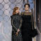 Presenters Isabelle Huppert and Angelina Jolie at the 75th Golden Globe Awards in Beverly Hills, California