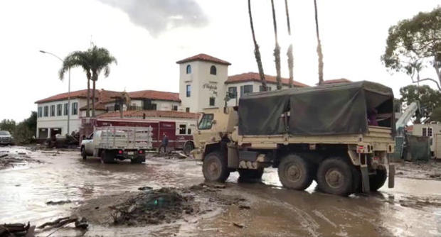 Military vehicles arrive to assist evacuation operations at an area damaged by mudslides in Montecito, California, U.S.
