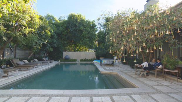 sharon-stone-with-lee-cowan-backyard-pool-angels-trumpet-tree-620.jpg