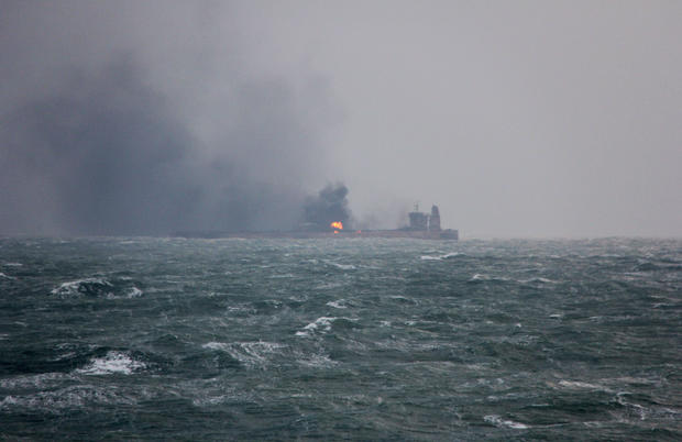 Smoke is seen from Panama-registered Sanchi tanker carrying Iranian oil that caught ablaze after it collided with a Chinese freight ship in the East China Sea