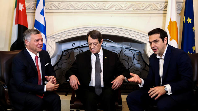 Cypriot President Nicos Anastasiades, Greek Prime Minister Alexis Tsipras and Jordan's King Abdullah talk during a meeting at the Presidential Palace in Nicosia