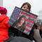 """Eight year-old Charlotte Turchi holds a """"Future Nasty Woman"""" sign during the local second annual Women's March in Cambridge"""