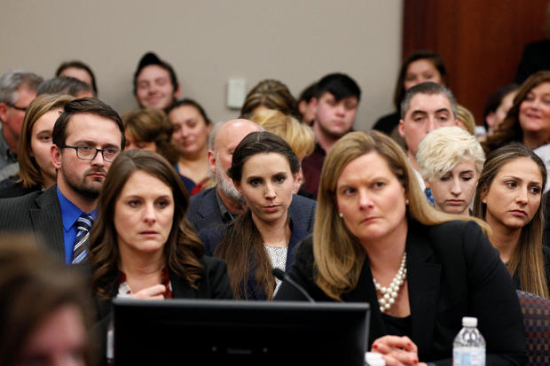 Victim Rachael Denhollander listens as Larry Nassar, a former team USA Gymnastics doctor who pleaded guilty in November 2017 to sexual assault charges, is sentenced in Lansing