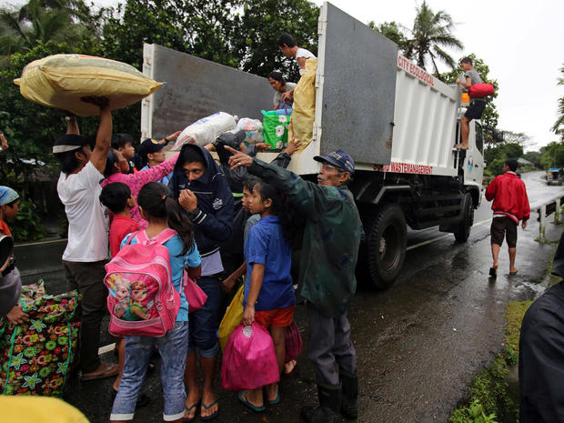 Residents with their belongings board a truck as they prepare to depart to the evacuation center after Mayon volcano spews ashes, in Ligao city, Albay province