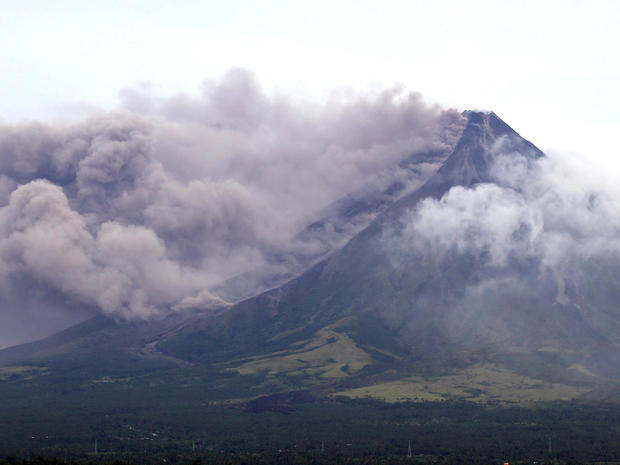 The Mayon volcano spews a column of ash during another mild eruption in Legazpi City, Albay province, south of Manila