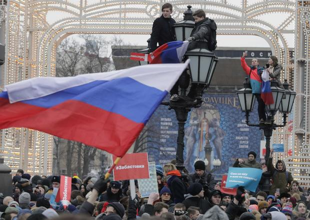 People gather in a square during a rally of supporters of Russian opposition leader Navalny in Moscow