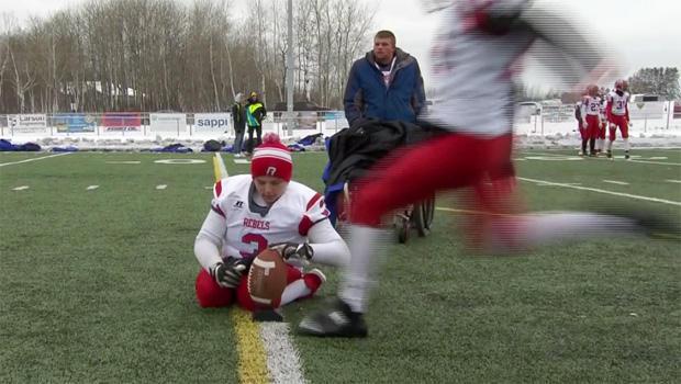 danny-lilya-holds-football-for-kicker-620.jpg