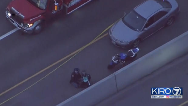 Cops: Motorcyclist detained after she shoots, kills driver in road rage dispute