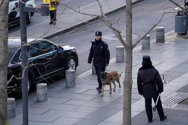 Police patrol outside the Joy City Mall in the Xidan district after a knife attack, in Beijing