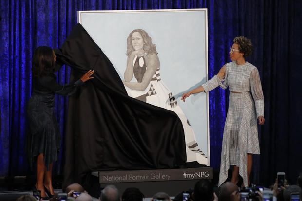 Artist Sherald and former first lady Michelle Obama participate in unveiling of Mrs. Obama's portrait at the Smithsonian's National Portrait Gallery in Washington