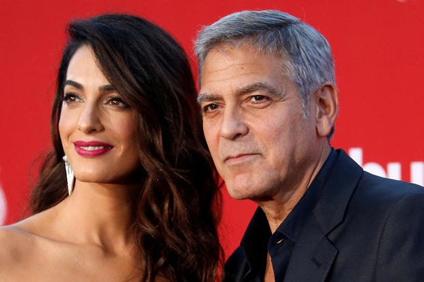 "Director George Clooney and his wife Amal attend the premiere for ""Suburbicon"" in Los Angeles, California, Oct. 22, 2017."