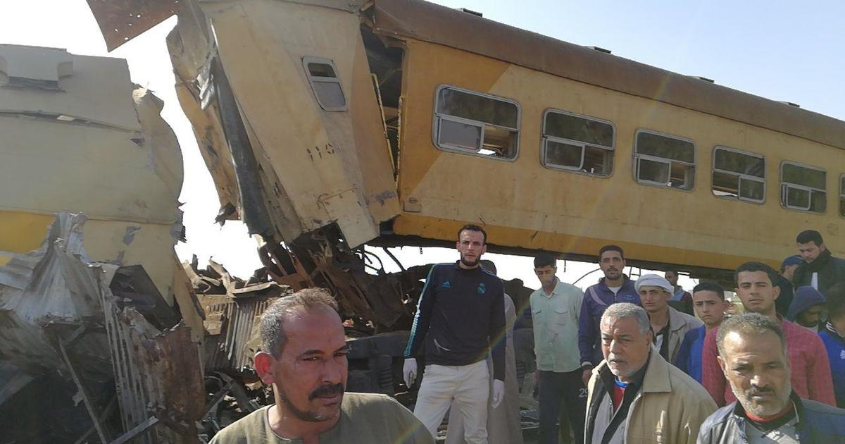 At least 10 killed as cargo, passenger trains collide