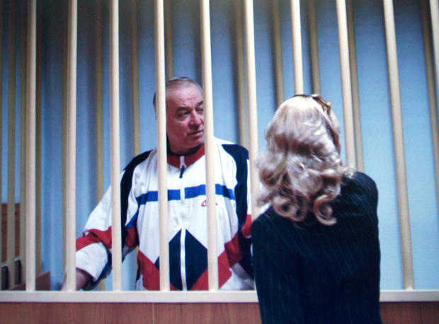 Sergei Skripal speaks to his lawyer from behind bars in this picture of a monitor outside a courtroom in Moscow, Russia, Aug. 9, 2006.