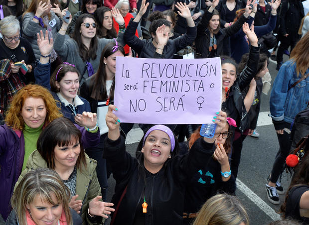 """A protester holds a poster reading """"The Revolution will be feminist or it won't happen"""" in a demonstration for women's rights on International Women's Day, in Bilbao"""