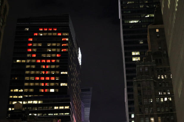 The female gender symbol is seen displayed on the Ernst and Young Building on International Women's Day in Times Square in New York City, New York