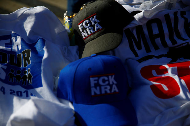 """Merchandise is seen before students and gun control advocates hold the """"March for Our Lives"""" event demanding gun control after recent school shootings at a rally in Washington"""