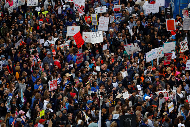 """People gather during the """"March for Our Lives"""", an organized demonstration to end gun violence, in downtown Los Angeles, California"""