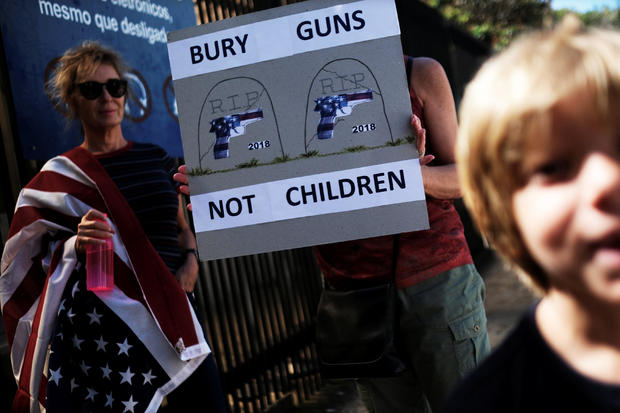 """People take part in the """"March for Our Lives"""", an organized demonstration to end gun violence in the United States, outside the U.S. Consulate in Sao Paulo"""