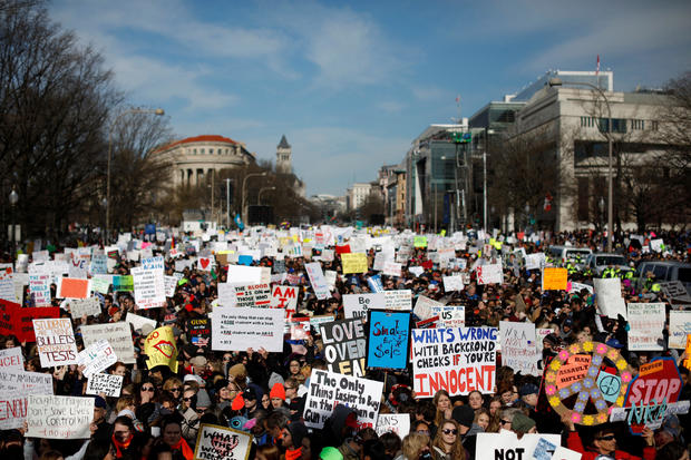 """Demonstrators gather as students and gun control advocates hold the """"March for Our Lives"""" event demanding gun control after recent school shootings at a rally in Washington"""