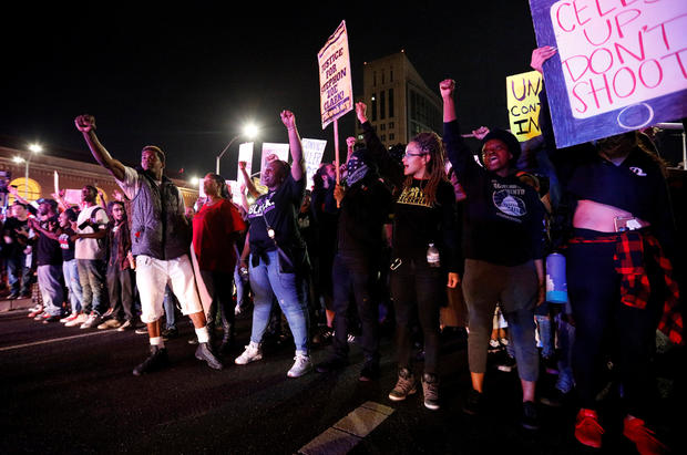 Demonstrators protest the police shooting of Stephon Clark, in Sacramento