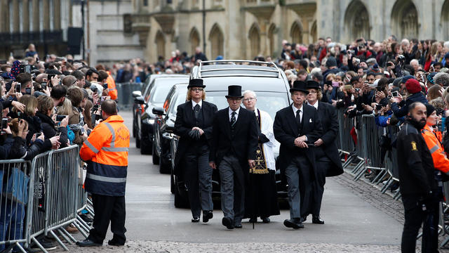 The funeral cortege arrives at Great St Marys Church, where the funeral of theoretical physicist Prof Stephen Hawking is being held, in Cambridge