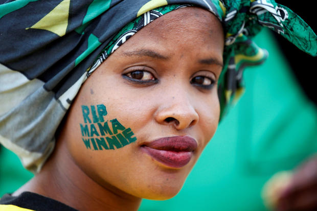 An African National Congress (ANC) supporter arrives at a memorial service for Winnie Madikizela-Mandela at Orlando Stadium in Johannesburg's Soweto township