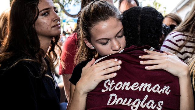 FILE PHOTO: Students from Marjory Stoneman Douglas High School attend a memorial following a school shooting incident in Parkland