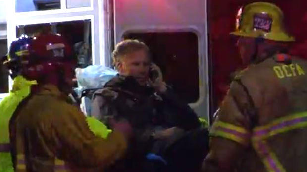 Actor Will Ferrell talks on a cellphone as he is loaded into an ambulance after an accident on a highway in Southern California on April 12, 2018, in this image capture from video.
