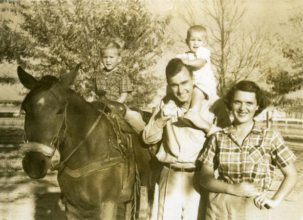 george-and-barbara-bush-with-george-and-robin-at-the-rodeo-grounds-in-midland-tx-october-1950-gbplm.jpg