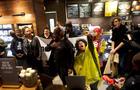 Protestors demonstrate inside a Center City Starbucks, where two black men were arrested, in Philadelphia