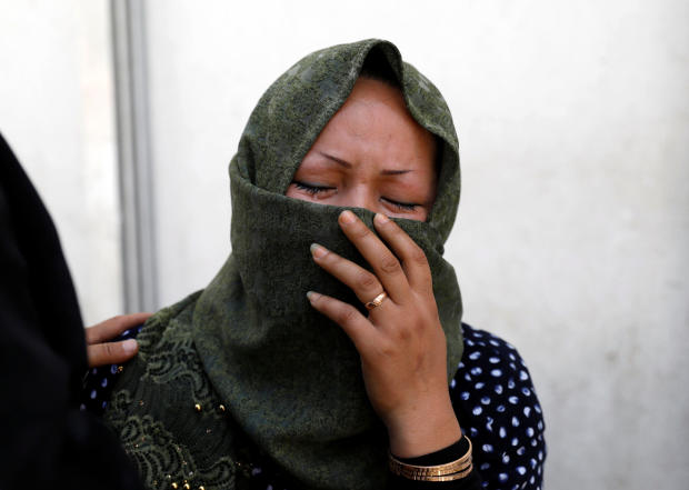 A woman mourns at a hospital after a suicide attack in Kabul