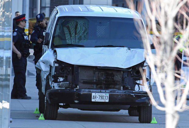 A damaged van seized by police is seen after multiple people were struck at a major intersection northern Toronto