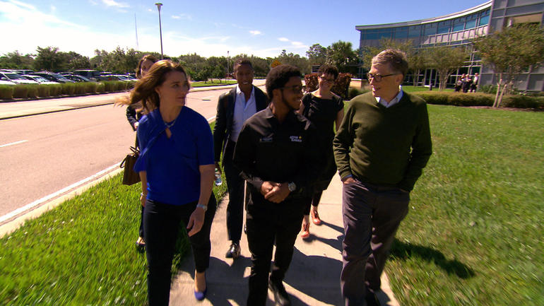 bill-melinda-gates-walk-with-ucf-staff.jpg