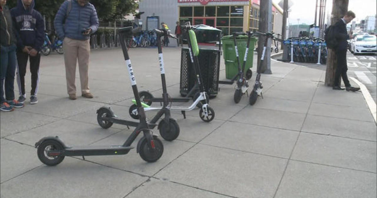 Dockless bike shares and scooters litter city streets