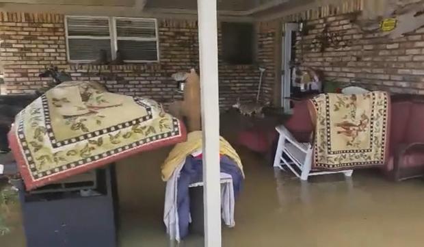 ctm-0501-flood-insurance-fema-melissa-miles-ricky-wall-home.jpg
