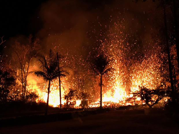 Handout photo of a new fissure spraying lava fountains as high as about 230 feet (70 m), according to United States Geological Survey, is shown from Luana Street in Leilani Estates subdivision on Kilauea Volcano's lower East Rift Zone in Hawaii