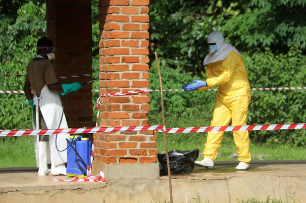 A health worker is sprayed with chlorine after visiting the isolation ward at Bikoro hospital, which received a new suspected Ebola case, in Bikoro
