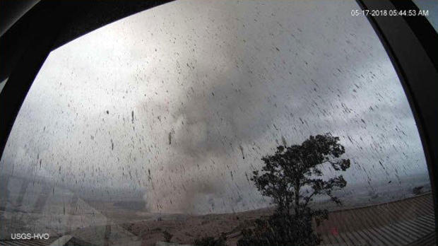 A screen capture from footage from a U.S. Geological Survey camera at the summit of Hawaii's Kilauea volcano shows an ash plume shooting from the erupting volcano early on May 17, 2018.