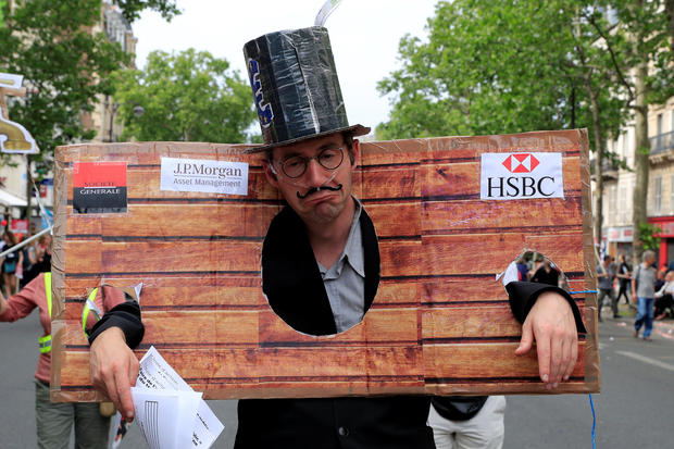 "A protester dressed as a banker attends a demonstration by French unions and France Insoumise"" (France Unbowed) political party to protest against government reforms, in Paris"