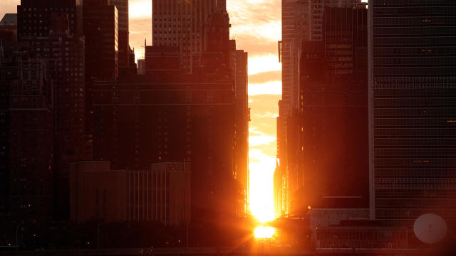 Sunset Alights Perfectly Between NYC Buildings During Manhattanhenge
