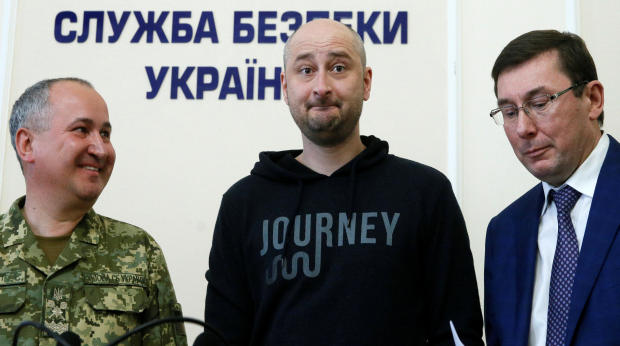 Russian journalist Arkady Babchenko, center, who was reported murdered in the Ukrainian capital on May 29, 2018, Ukrainian Prosecutor General Yuriy Lutsenko, right, and head of the state security service Vasily Gritsak attend a news briefing in Kiev, Ukra