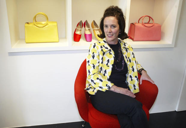 Designer Kate Spade poses among handbags and shoes from her collection in New York May 13, 2004.