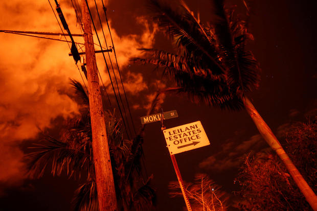 Lava illuminates a sign in Leilani Estates