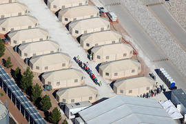 "Immigrant children, many of whom have been separated from their parents under a new ""zero tolerance"" policy by the Trump administration, are being housed in tents next two the Mexican border in Tornillo, Texas"